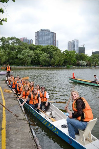 Group of students in rowing boat